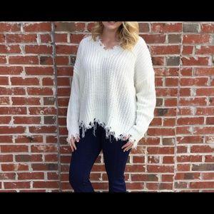 White fringed edged sweater
